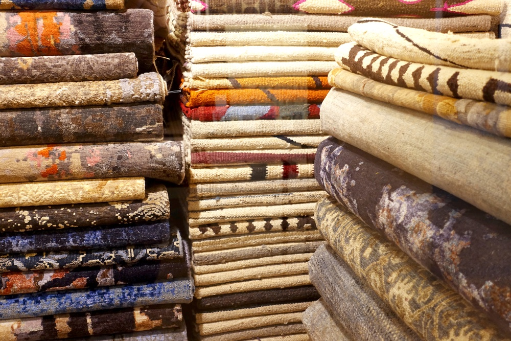 Stacks of Antique Ethnic Rugs and Blankets